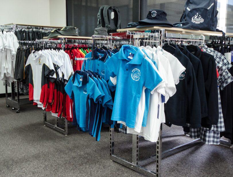Uniforms hanging on shop rails